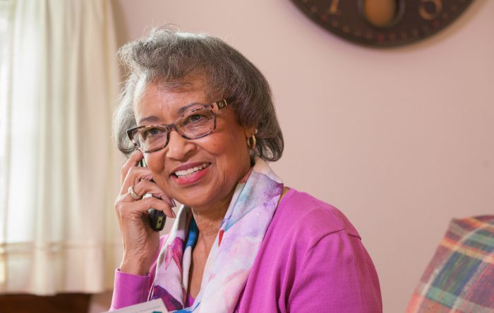 female senior on the phone
