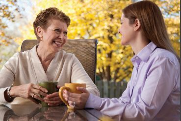 Caregiver with client socializing.