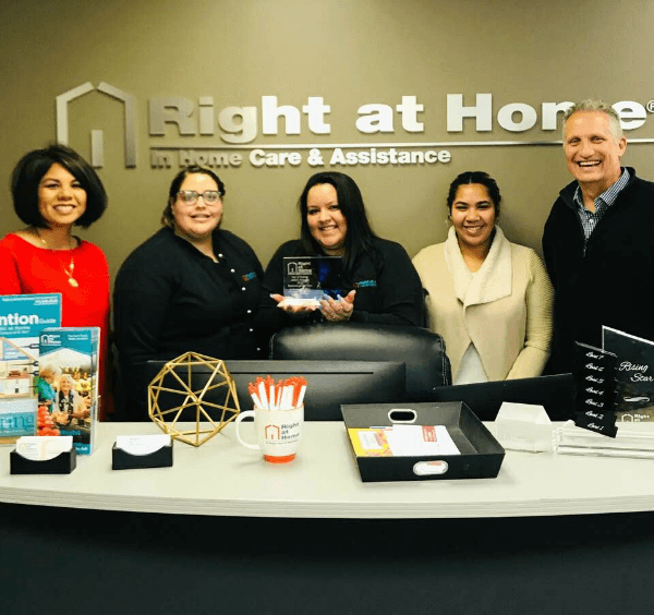 Right at Home team with award from City of Cypress