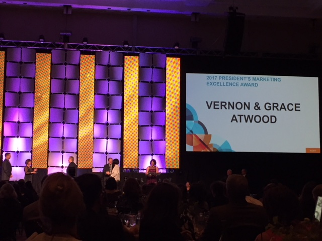 Grace and Vernon Atwood presented with the President's Marketing Excellence Award at Home Improvement 2017