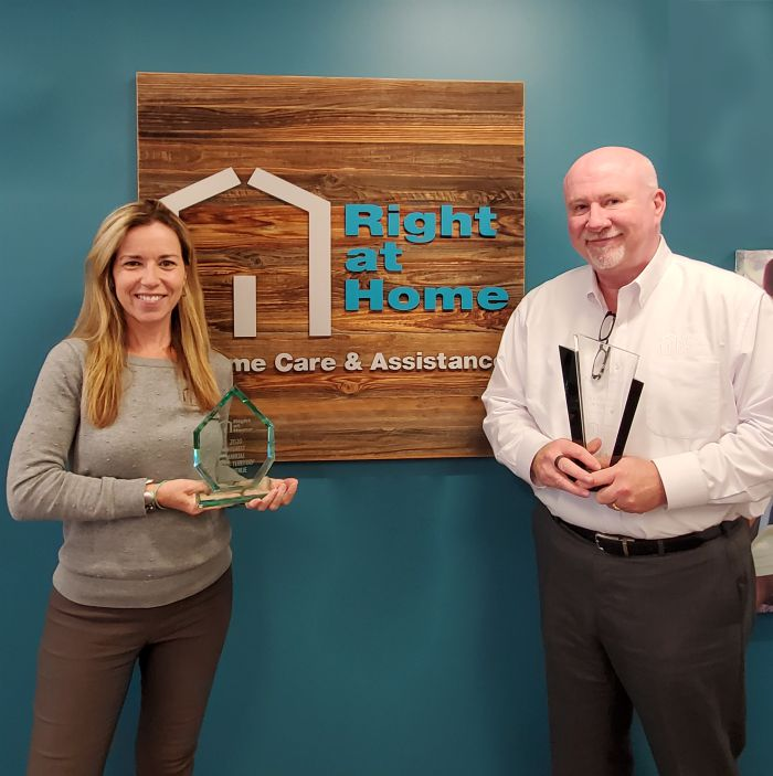 Rosaleen Doherty and Jay Kenny, owners of Right at Home Boston and North with awards won within the Right at Home Franchise System.