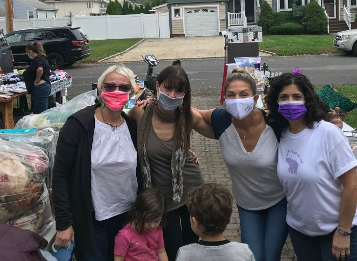 Right at Home South Shore Long Island Owner Jeanine Gagliano and 3 female friends and two children at the ADRC Fundraiser Yard sale for their virtual walk to end Alzheimer