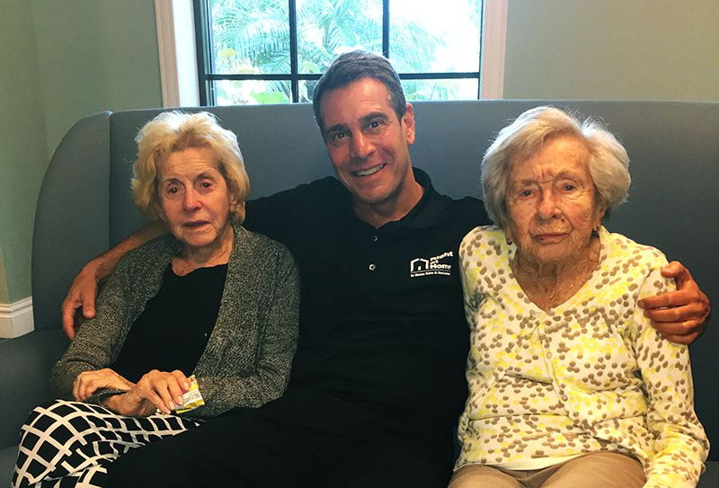 Bruce Gropper sitting with two female senior clients