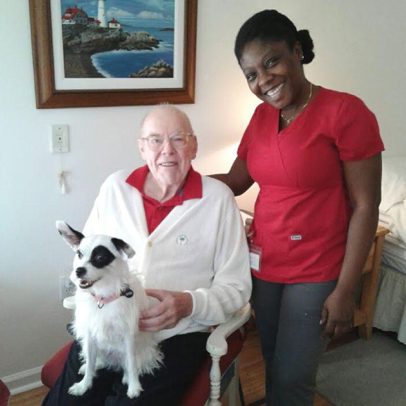 Caregiver, a senior client and his dog