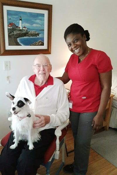 senior clients posing with Right at Home caregiver