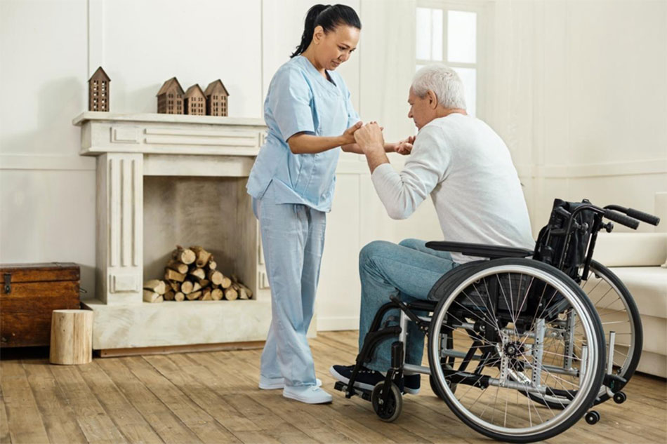 caregiver assisting senior in wheelchair