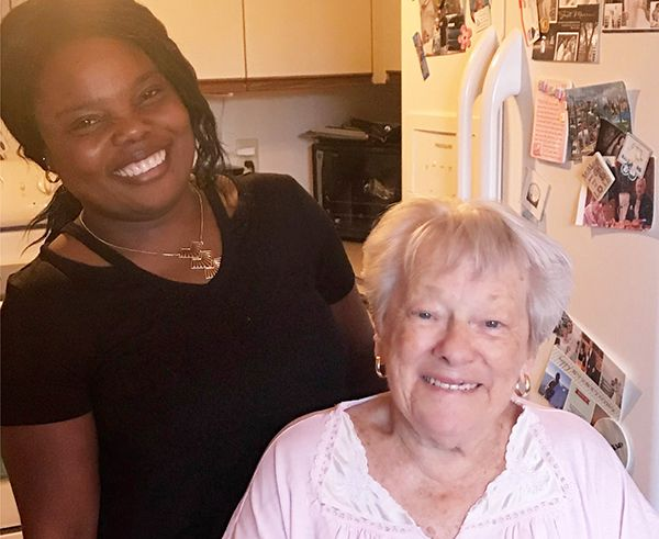 Caregiver and client smiling