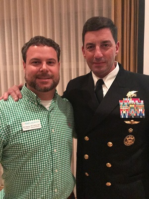 Right at Home Owner Bill Osborne pictured with Navy Captain Geno Paluso