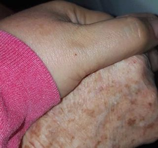 Holding Hands with Caregiver Lynn