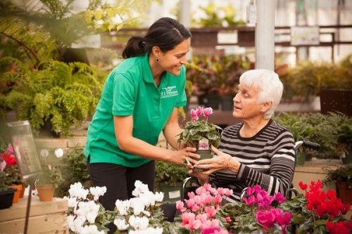 caregiver and client shopping for flowers