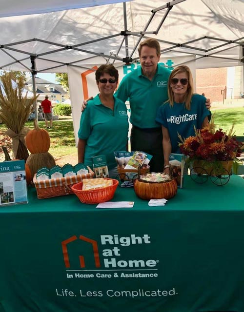 Ted Bernhardt, President and Owner of Right at Home Bedford stands with Director of Client Services, Laura Reynolds and Director of Sales and Marketing, Elizabeth Kaupp September 2019 at Bedford Day.