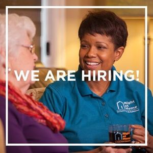 caregiver with client - now hiring