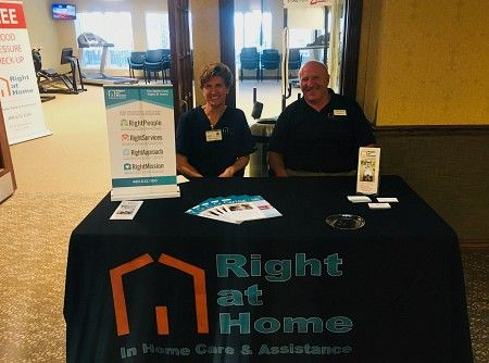 Owner Mark Leuer and Selena from Right at Home East Valley Phoenix at the Copper Springs Grand Opening in Gilbert, Arizona