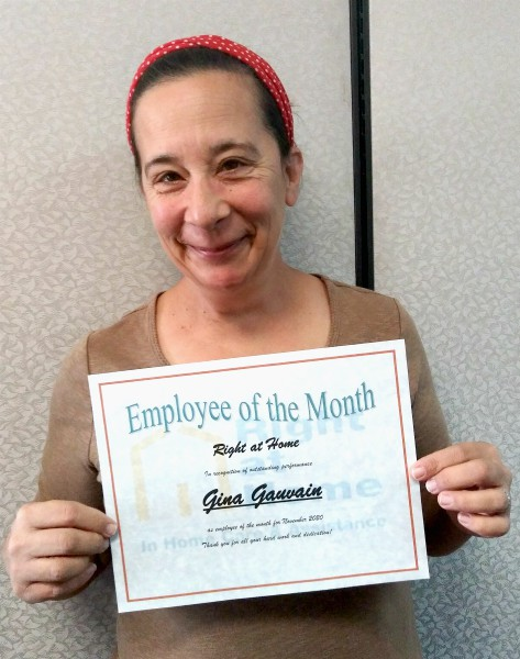 Gina G. holding Employee of the Month certificate