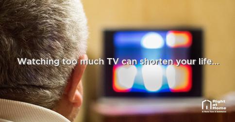 senior watching tv