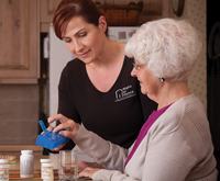 Caregiver aiding a Senior