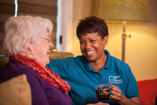 caregiver and client enjoying leisure activity