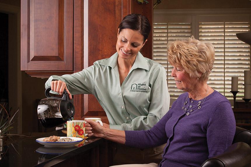 Caregiver poring coffee.