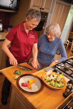 Caregiver preparing meal