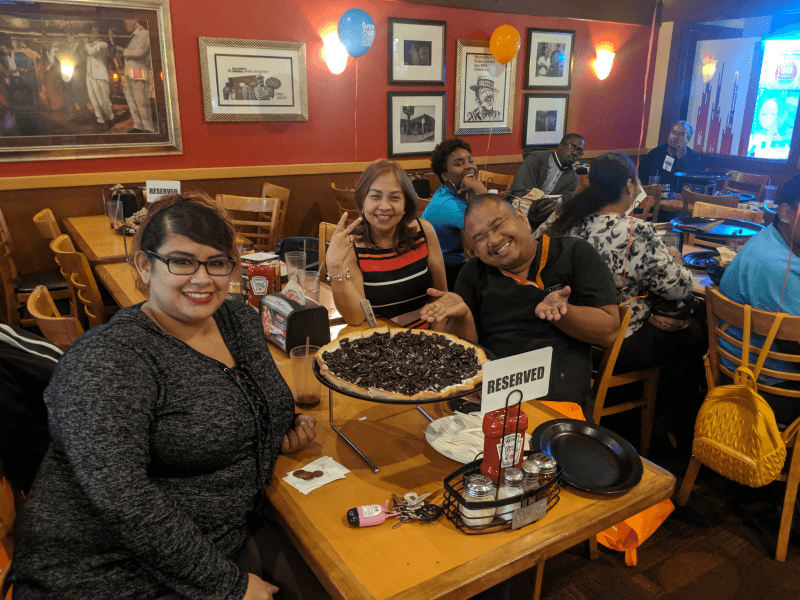 Group around table at Caregiver Appreciation Party at Shakey's in Burbank