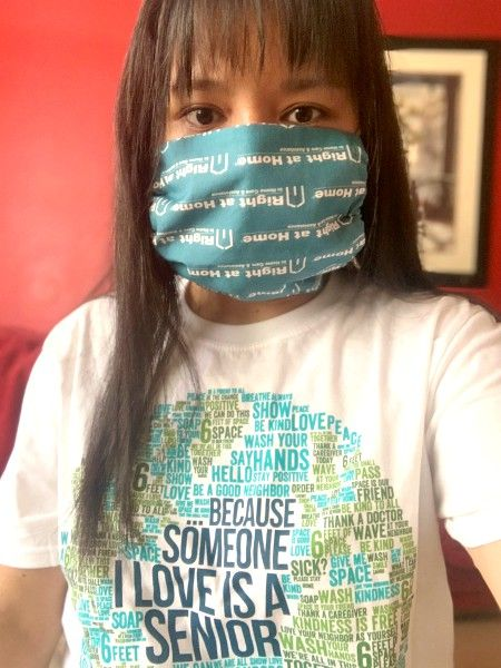 Caregiver wearing Right at Home logo'd mask and Someone I Love is a Senior T-shirt