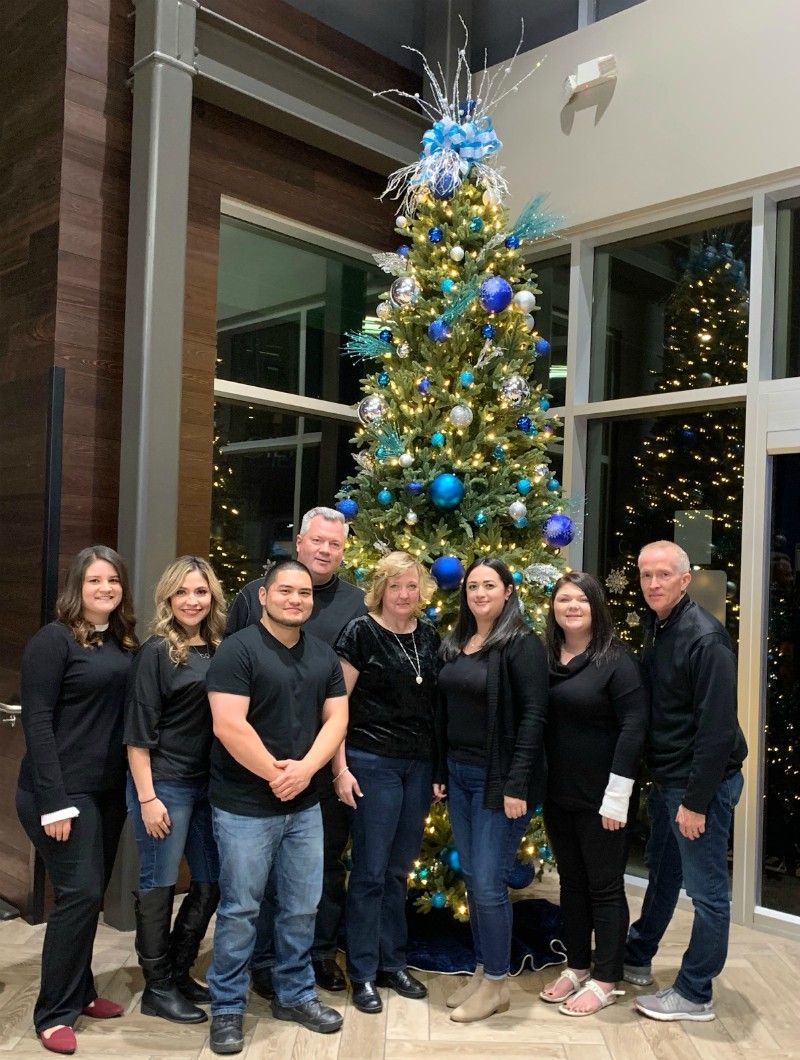 Right at Home Green Valley Tucson team in front of Christmas tree