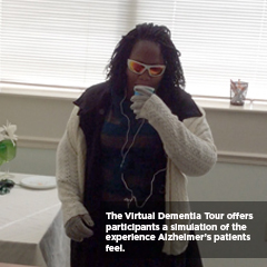 caregiver sipping water in virtual dementia tour
