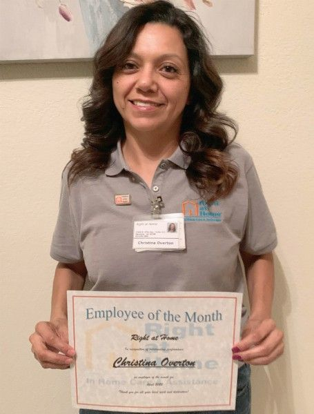 Photo of Employee of the Month Christina O. holding certificate