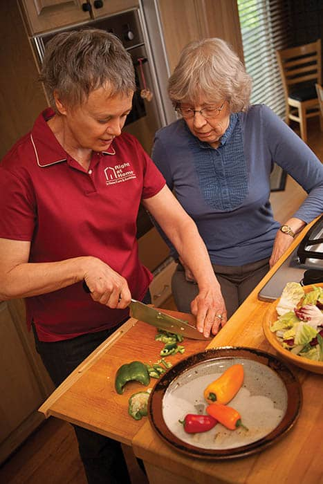 Caregiver doing meal prep with client