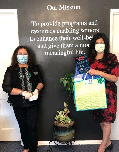 Carmen on left and Senior Advocate Darlene Weber on right both in masks