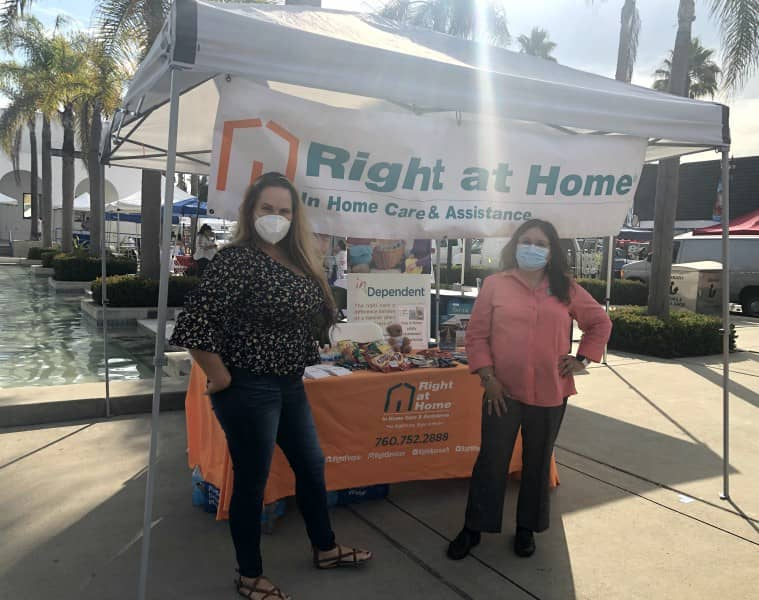 Carmen and Michelle under Right at Home tent at North County Wellness Fair