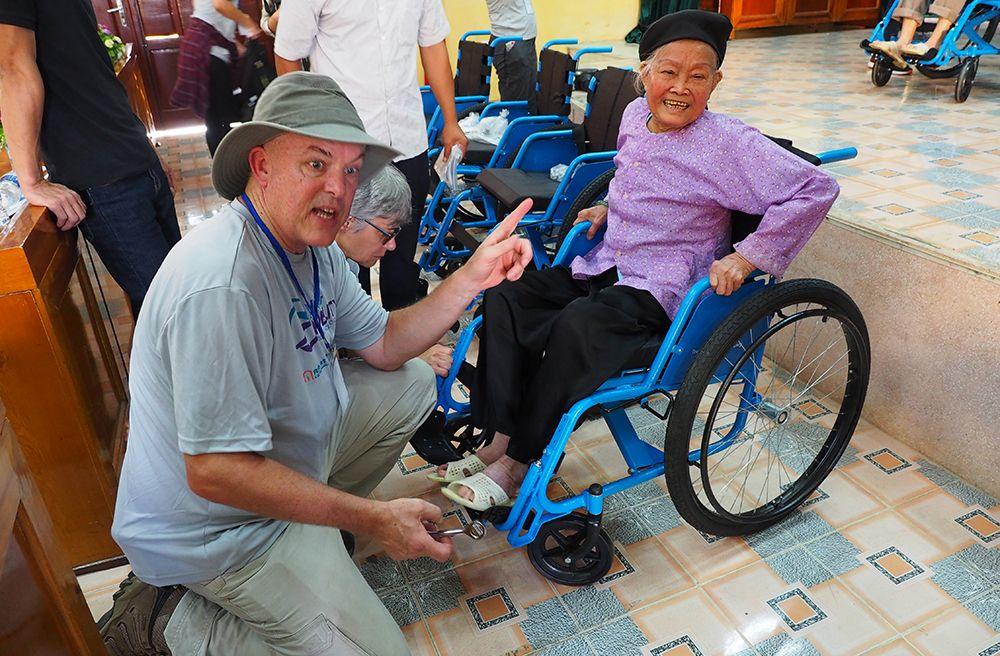 Jon with wheelchair recipient