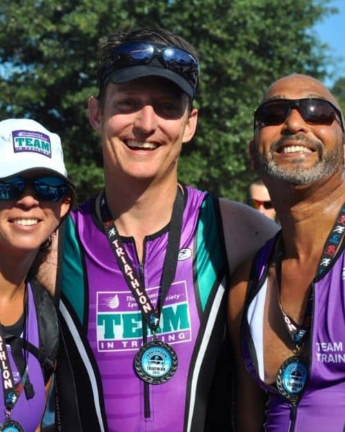 Tim Petlin, Right at Home owner, in middle of two other marathon runners