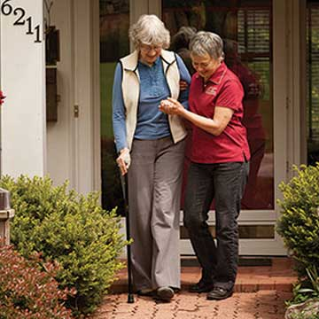 Caregiver Helping Client Go for a Walk